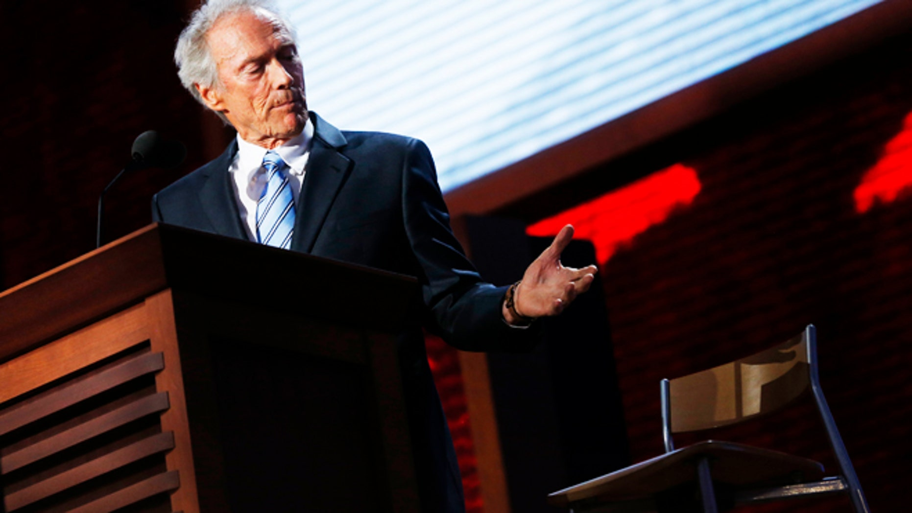 Actor Clint Eastwood addresses an empty chair and questions it as if it is U.S. President Obama, as he endorses Republican presidential nominee Mitt Romney during the final session of the Republican National Convention in Tampa, Florida, August 30, 2012.   REUTERS/Eric Thayer (UNITED STATES  - Tags: POLITICS ELECTIONS TPX IMAGES OF THE DAY)   - RTR37B1D