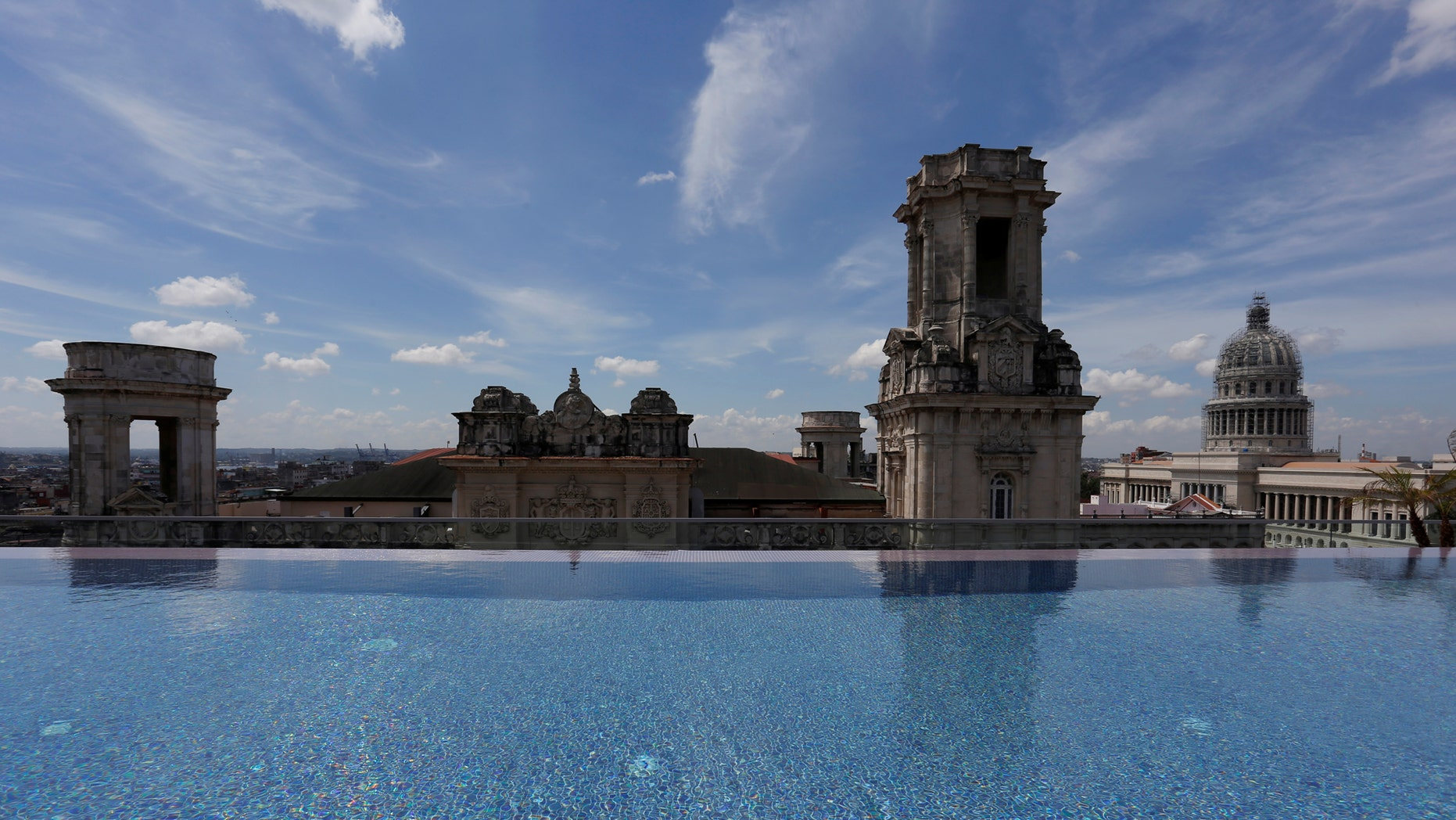 File photo: A historic building is seen from the rooftop infinity pool at the Gran Hotel Manzana, owned by the Cuban government and managed by Swiss-based Kempinski Hotels SA, in Havana, Cuba May 12, 2017. Picture taken May 12, 2017. (REUTERS/Stringer)