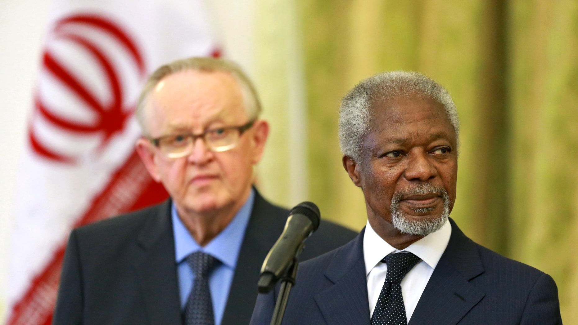"Kofi Annan, former U.N. secretary general, right, reads a statement at the conclusion of his meeting with Iran's Foreign Minister Mohammad Javad Zarif  in Tehran, Iran, Monday, Jan. 27, 2014, as Martti Ahtisaari, pormer president of Finland, left, listens. The former head of the United Nations urged Iran Monday to build on a historic deal reached with world powers in November and work toward a final settlement over its contested nuclear program. Annan, who is heading a group of ex-world leaders known as ""The Elders,"" made the comments after a meeting with Iran's Foreign Minister Mohammad Javad Zarif Monday. (AP Photo/Ebrahim Noroozi)"
