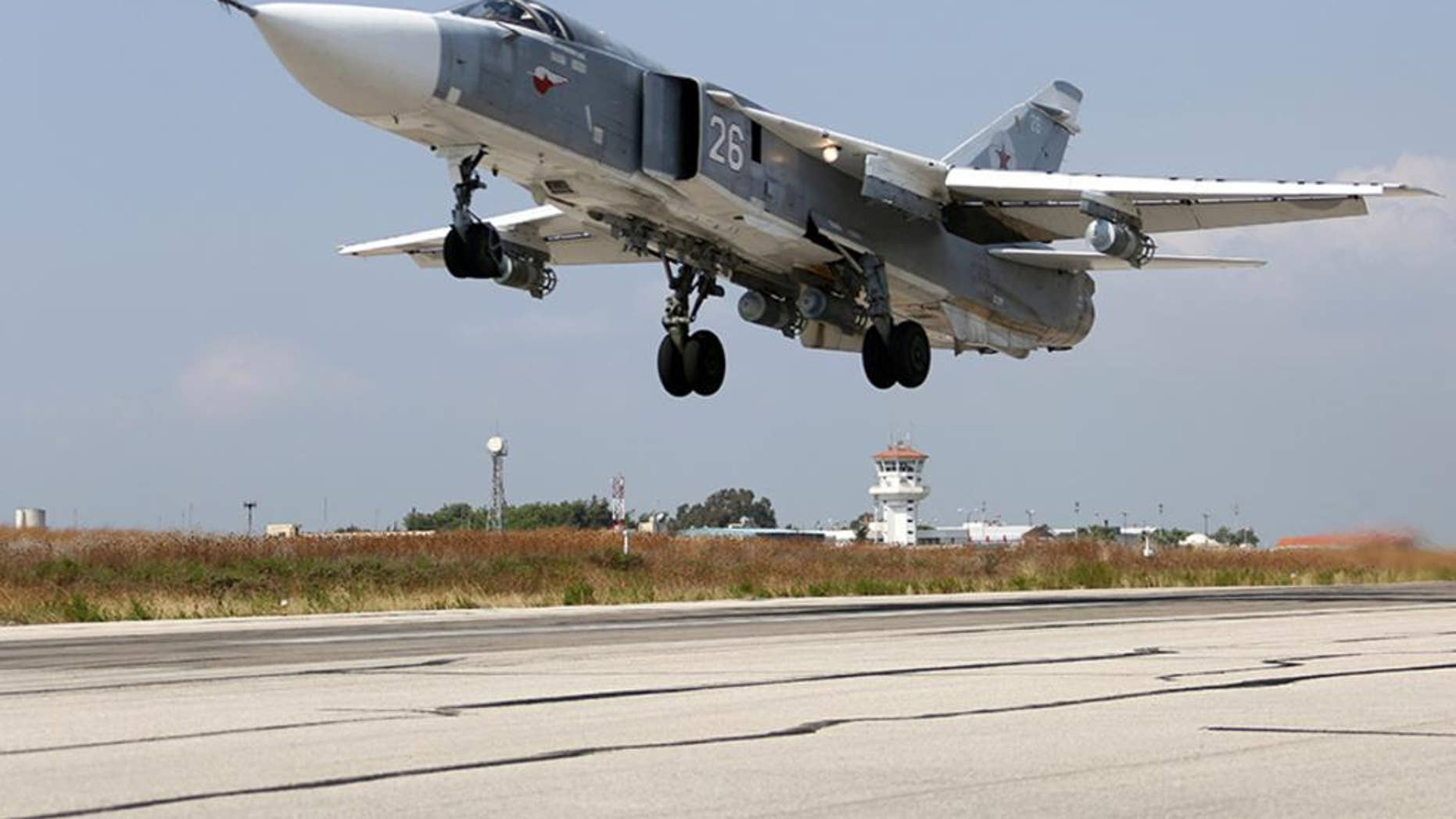 In this photo taken from Russian Defense Ministry official web site on Tuesday, Oct. 6, 2015, a Russian  SU-24M jet fighter takes off from an airbase Hmeimim in Syria. A spokeswoman for the Russian foreign ministry has rejected claims that Russia in its airstrikes in Syria is targeting civilians or opposition forces. (Russian Defense Ministry Press Service via AP)