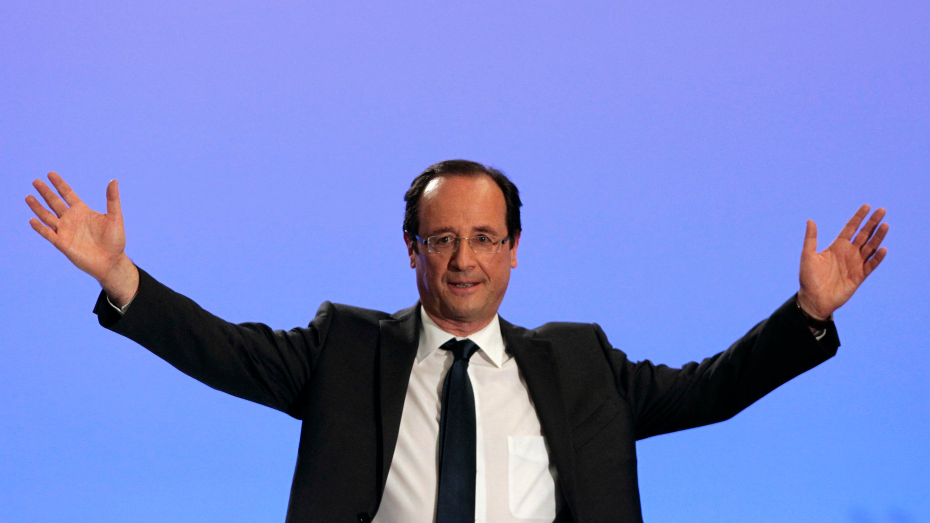 April 22: Socialist Party candidate for the presidential election Francois Hollande waves to supporters after the presidential election first round, in Tulle, central France.