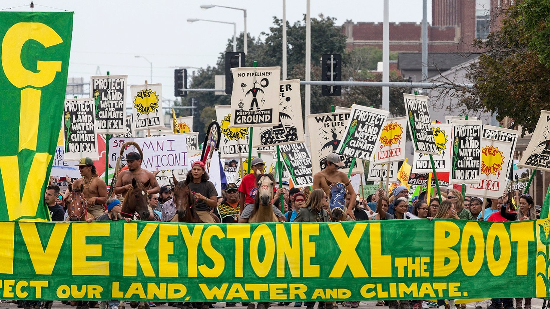 Demonstrators against the Keystone XL pipeline march in Lincoln, Neb.,  Aug. 6, 2017.