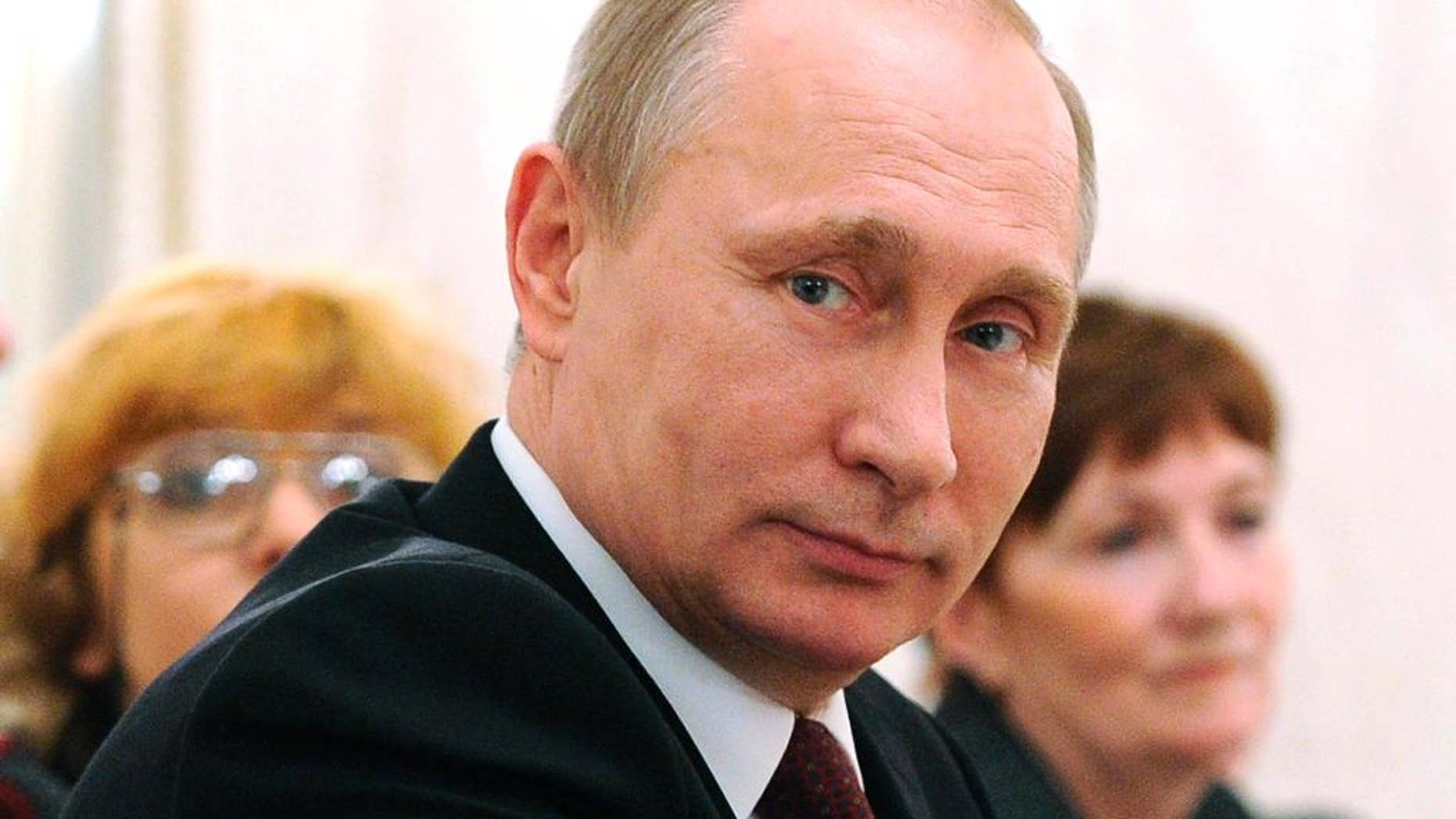 Russian President Vladimir Putin attends an International Women's Day celebration in the Kremlin, in Moscow, Russia, Sunday, March 8, 2015.  (AP Photo/RIA-Novosti, Mikhail Klimentyev, Presidential Press Service)