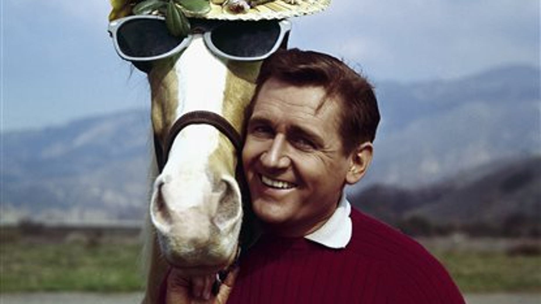 """FILE - In this March 22, 1962 file photo, actor Alan Young poses with the """"Mister Ed,"""" horse. Young died Thursday, May 19, 2016. He was 96. (AP Photo, File)"""