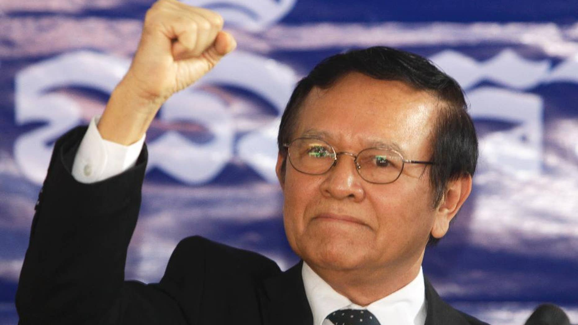 FILE - In This Friday, Sept. 9, 2016, file photo, opposition Cambodia National Rescue Party Deputy President Kem Sokha gestures during a speech at the party headquarters in Phnom Penh, Cambodia. Cambodia's King Norodom Sihamoni's pardon Friday of Kem Sokha allows him to avoid five months in prison for failing to answer a summons in a case involving his alleged mistress. (AP Photo/Heng Sinith, File)