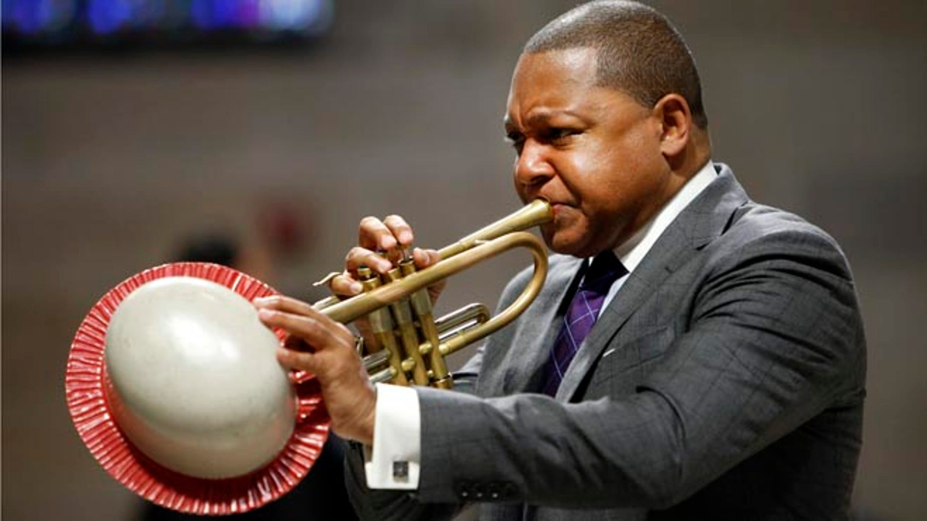 FILE - In this Sept. 20, 2014, file photo, musician Wynton Marsalis performs during a memorial service for actress Ruby Dee at The Riverside Church in New York. It was announced Wednesday, March 11, 2015, that Marsalis is scratching a concert in Venezuela amid rising tensions between Venezuela and the U.S. that are making it harder for U.S. citizens to travel to the South American country. (AP Photo/Jason DeCrow, File)