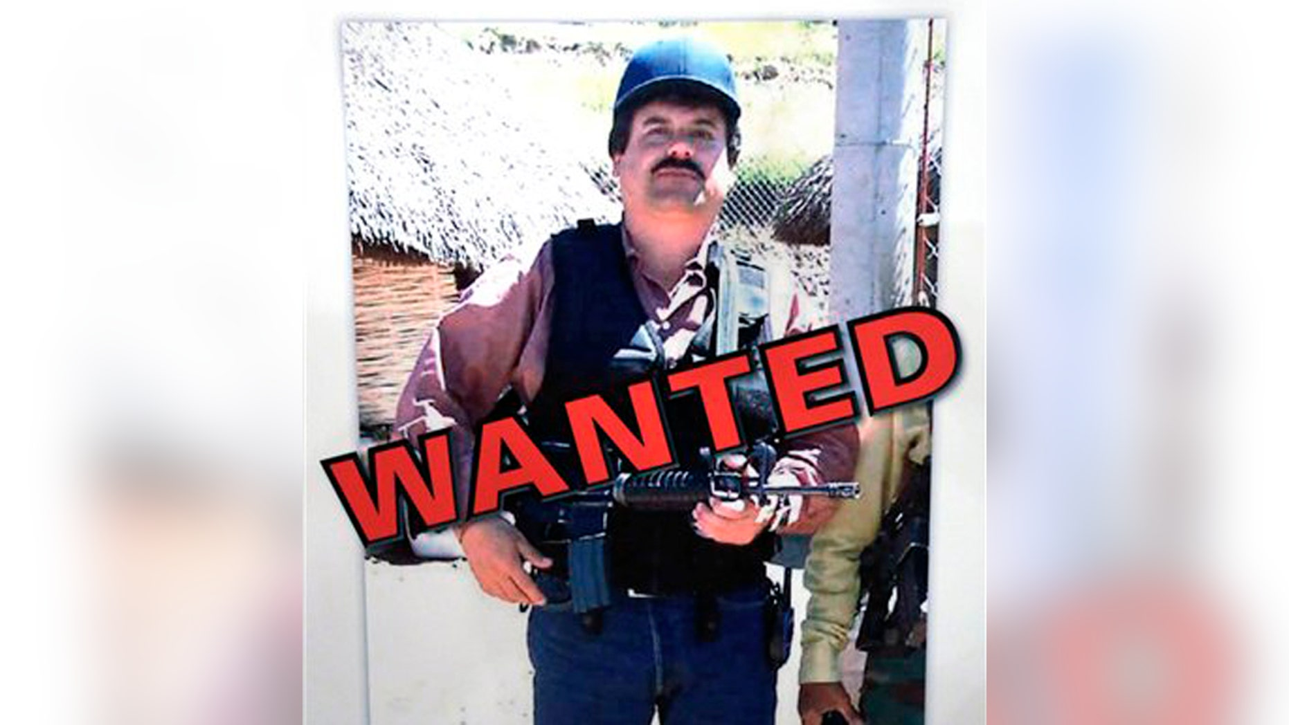 """FILE - In a Thursday, Feb. 14, 2013, file photo, a poster displayed at a Chicago Crime Commission news conference in Chicago, shows Joaquin ``El Chapo'' Guzman, who was deemed Chicago's Public Enemy No. 1.  In a scheme befitting a caper movie, Mexico's most powerful drug lord, Joaquin """"El Chapo"""" Guzman, escaped late Saturday July 11, 2015 from a maximum security prison through a 1.5-kilometer (1 mile) tunnel from a small opening in the shower area of his cell, the country's top security official announced. (AP Photo/M. Spencer Green, File)"""