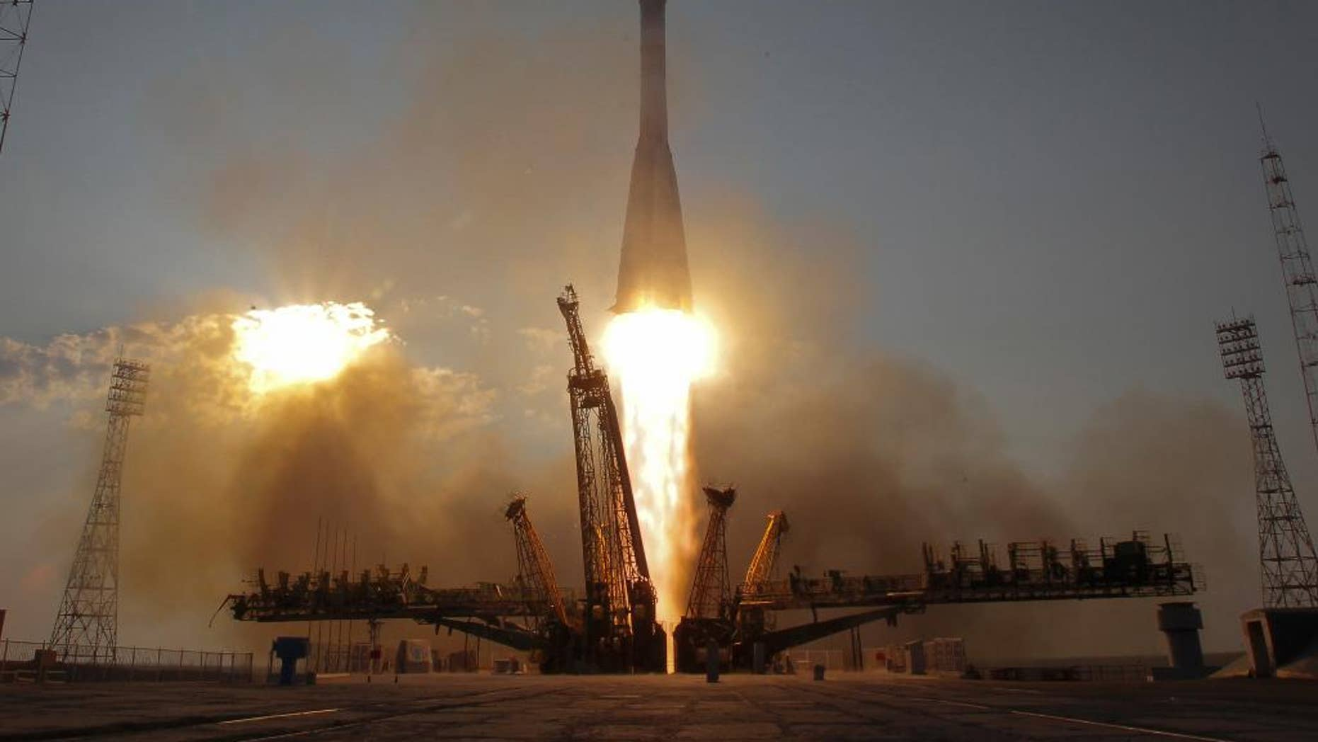 FILE - In this Thursday, July 7, 2016, file photo, the Soyuz-FG rocket booster with Soyuz MS space ship carrying a new crew to the International Space Station, ISS, blasts off at the Russian leased Baikonur cosmodrome, Kazakhstan. The capsule carrying astronauts from Russia, Japan and the United States has docked with the International Space Station Saturday after a two-day voyage. (AP Photo/Dmitri Lovetsky, File)