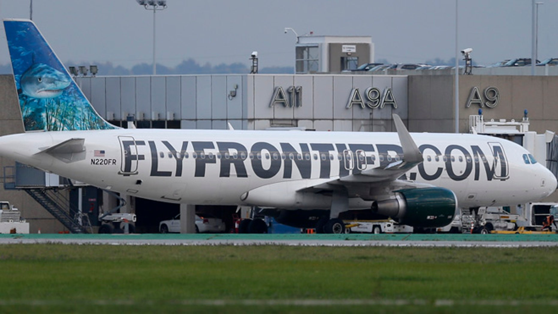 Oct. 15, 2014: The Frontier Airlines plane that Amber Vinson flew from Cleveland to Dallas on Monday, taxies away from the terminal at Cleveland Hopkins International Airport in Cleveland.