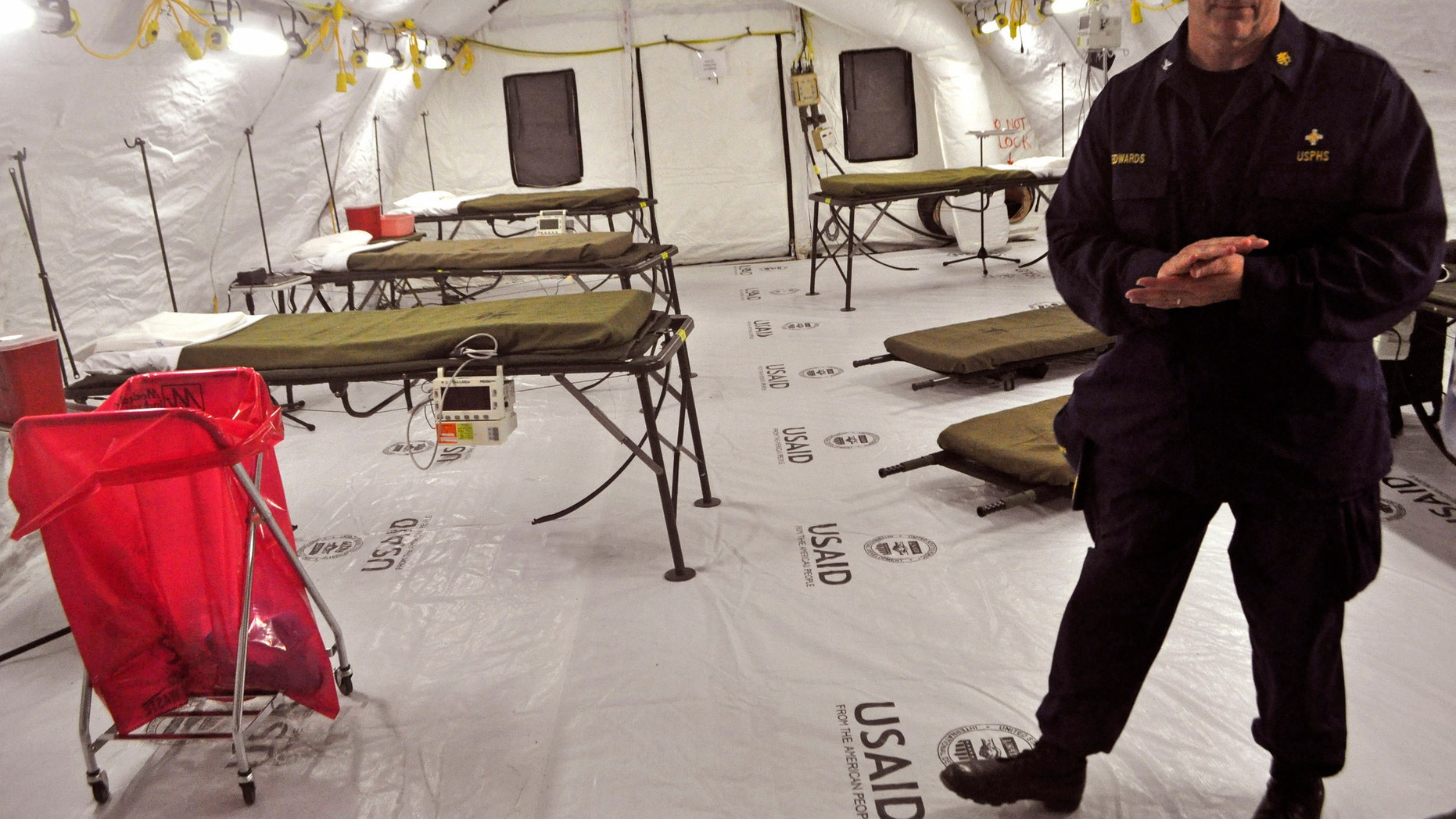Nov. 5, 2014: In this file photo, on the outskirts of the city of Monrovia, Liberia, a health worker stands inside a medical tent that forms part of a new American clinic to be used for the treatment of people suffering from the Ebola virus.