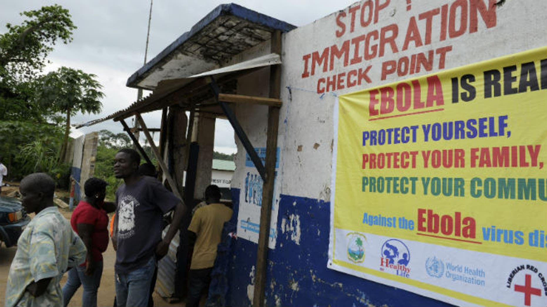 Liberian soldiers check people traveling in Bomi County August 11, 2014. (REUTERS/Stringer)