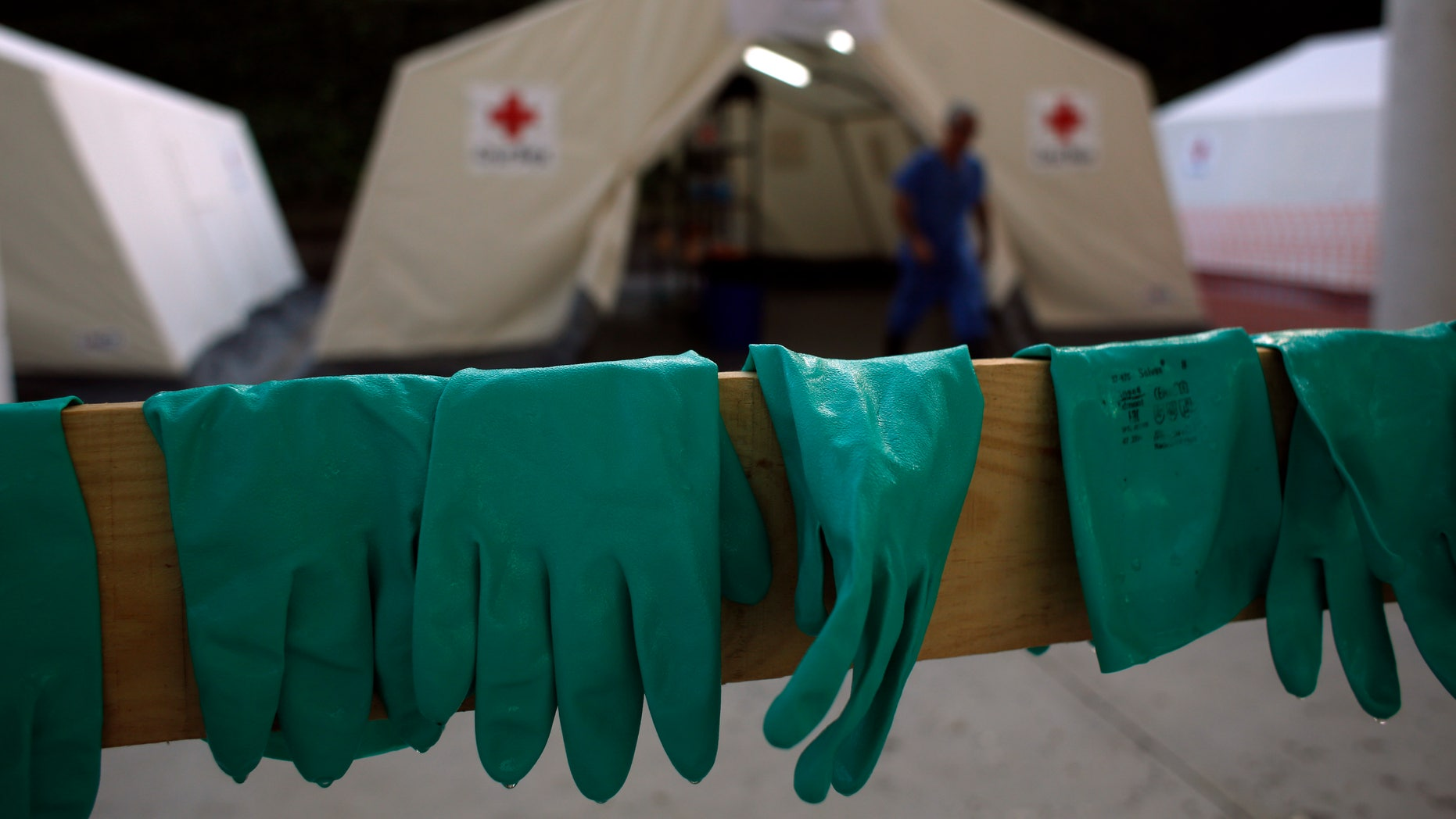 Gloves are left to dry after an Ebola training session held by Spain's Red Cross in Madrid October 29, 2014. REUTERS/Susana Vera