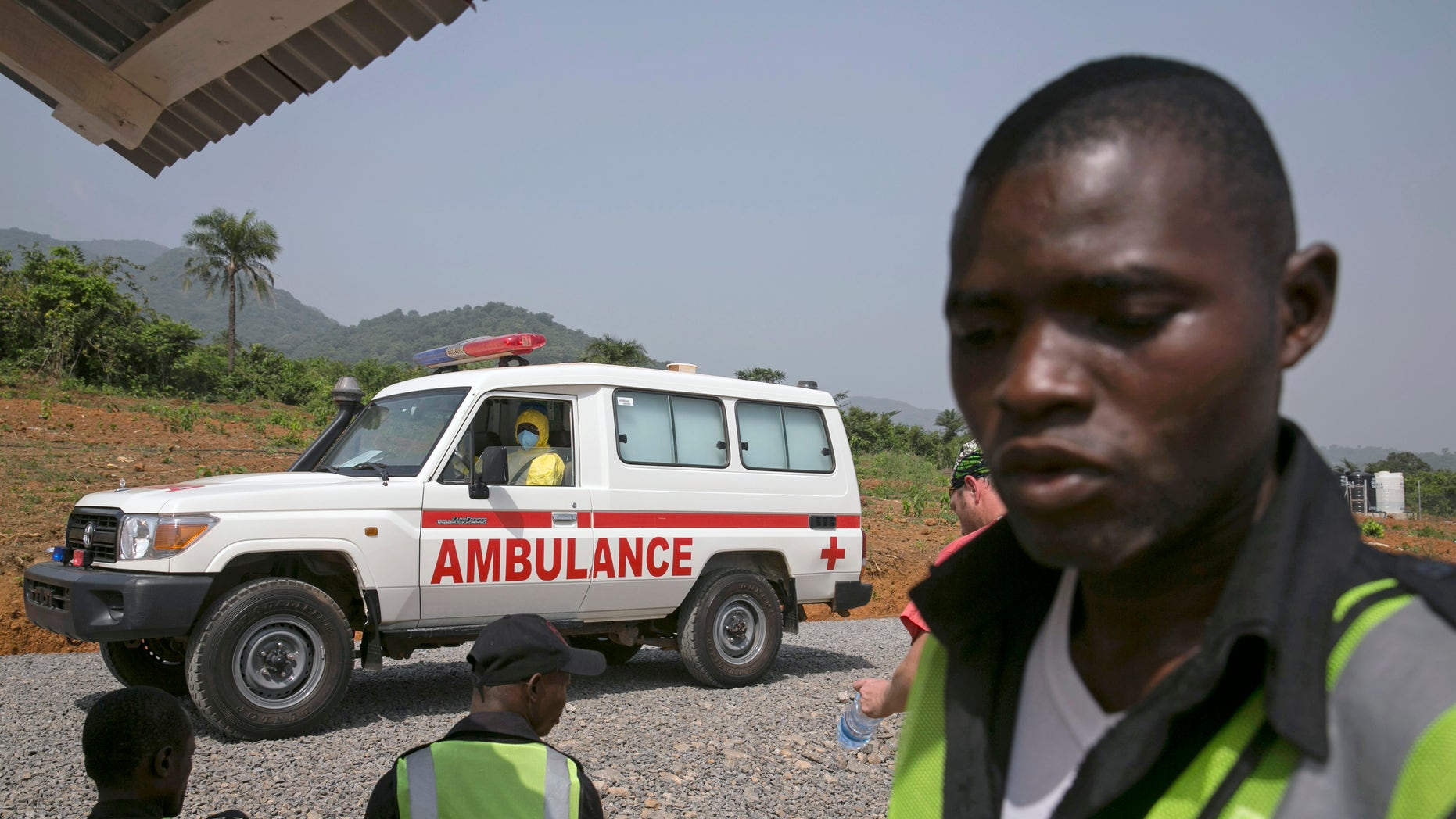 An ambulance transporting a newly admitted Ebola patient drives to the entrance of the Save the Children Kerry Town Ebola treatment centre outside Freetown, Sierra Leone, December 22, 2014.