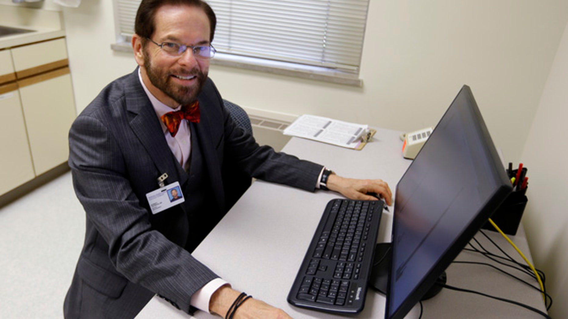 Aug 21, 2014: Dr. Robert Palinkas, director of the McKinley Health Center at the University of Illinois, poses in an exam room in Urbana, Ill. (AP)