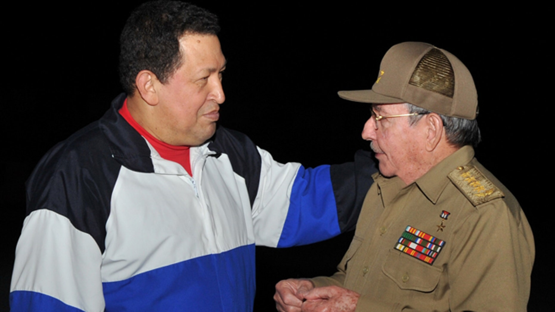 Dec. 10, 2012: In this picture released Tuesday, Dec. 11, 2012 by Cuba's state newspaper Granma, Cuba's President Raul Castro, right,  receives Venezuela's President Hugo Chavez at the Jose Marti International airport in Havana, Cuba.