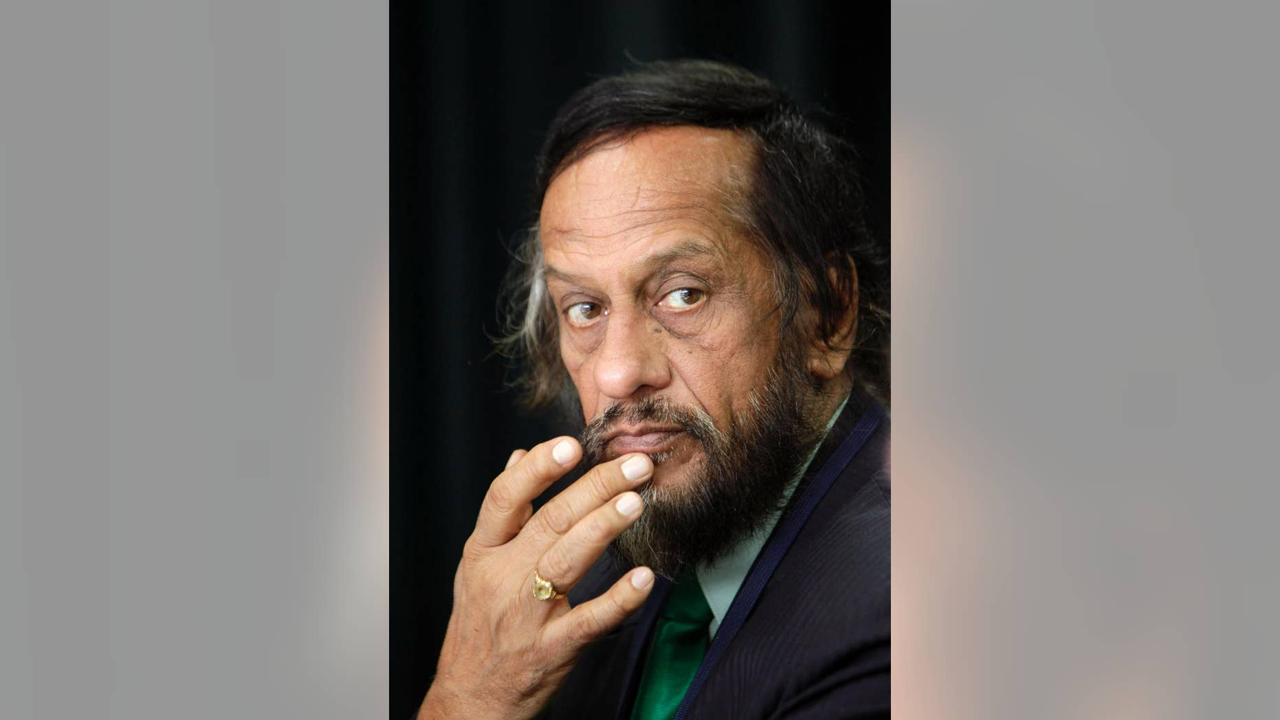 FILE - In this Dec. 1, 2009, file photo, Chairman of the United Nations panel on climate change Rajendra Pachauri looks on at a press conference in New Delhi, India. The former chairman of the U.N. climate panel has been removed from his job as head of a top energy institute in India following allegations of sexual harassment. The Energy and Resources Institute announced late Thursday, July 23, 2015 that Pachauri would be replaced by Arun Mathur, an energy efficiency expert. (AP Photo/Gurinder Osan, File)