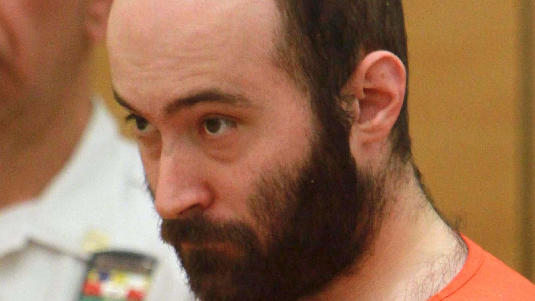 Levi Aron, accused of abducting and dismembering eight-year-old boy Leiby Kletzky, is arraigned in Brooklyn criminal court in New York in 2011.