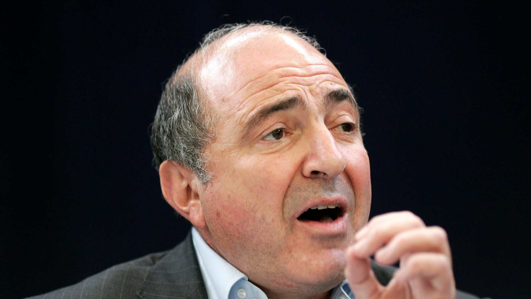 A  Wednesday, July 18, 2007 photo from files showing Russian exile Boris Berezovsky, a close friend of former Russian agent Alexander Litvinenko who was poisoned by Polonium 2-10, speaking to the media in a news conference in London.