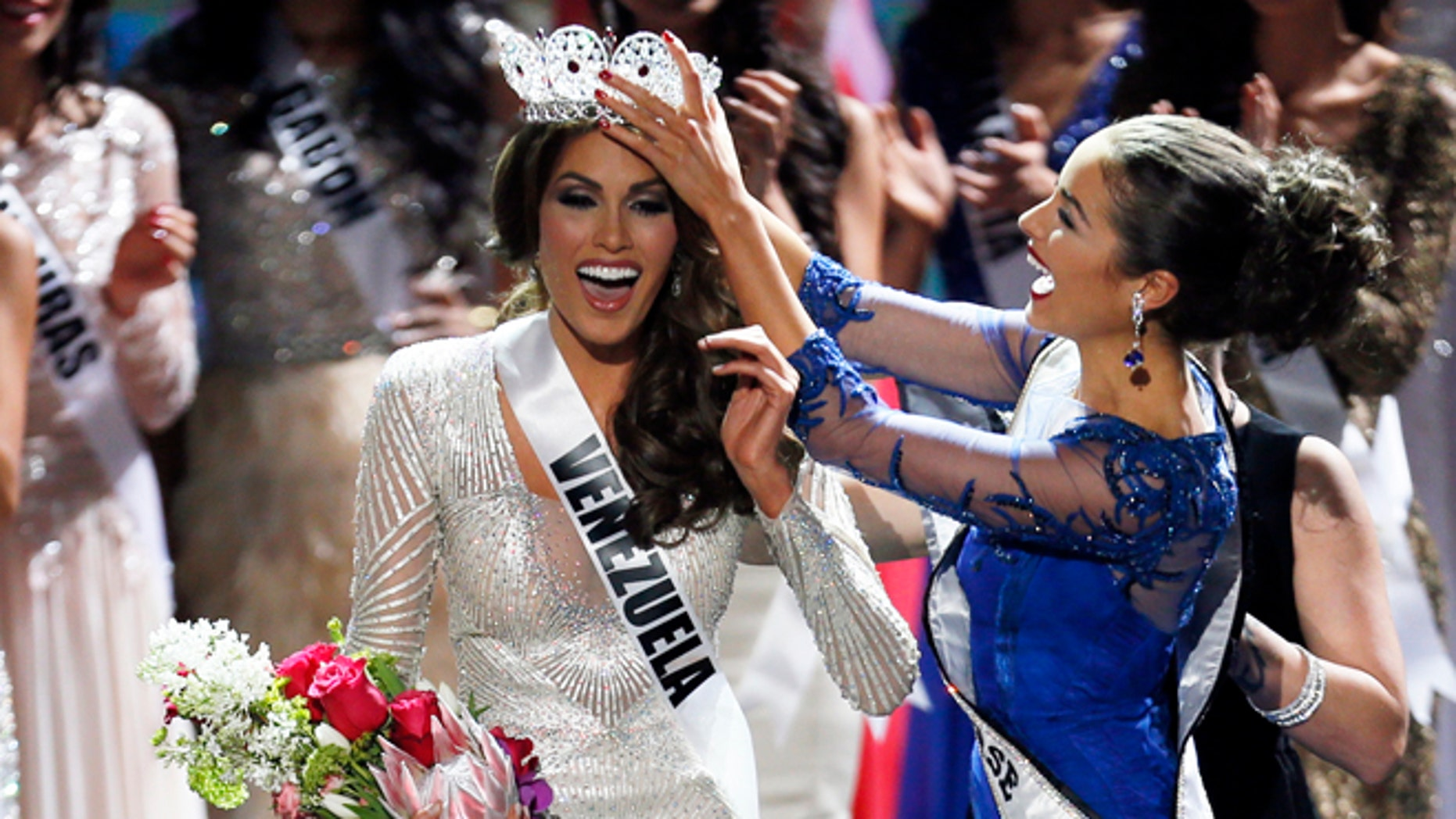 FILE  - In this Nov. 9, 2013 file photo, Miss Universe 2012 Olivia Culpo, from the United States, right, places the crown on Miss Venezuela Gabriela Isler during the 2013 Miss Universe pageant in Moscow, Russia. Isler is scheduled to attend a news conference, Thursday, Oct. 2, 2014, along with pageant owner Donald Trump to announce the next Miss Universe pageant. (AP Photo/Pavel Golovkin, File)