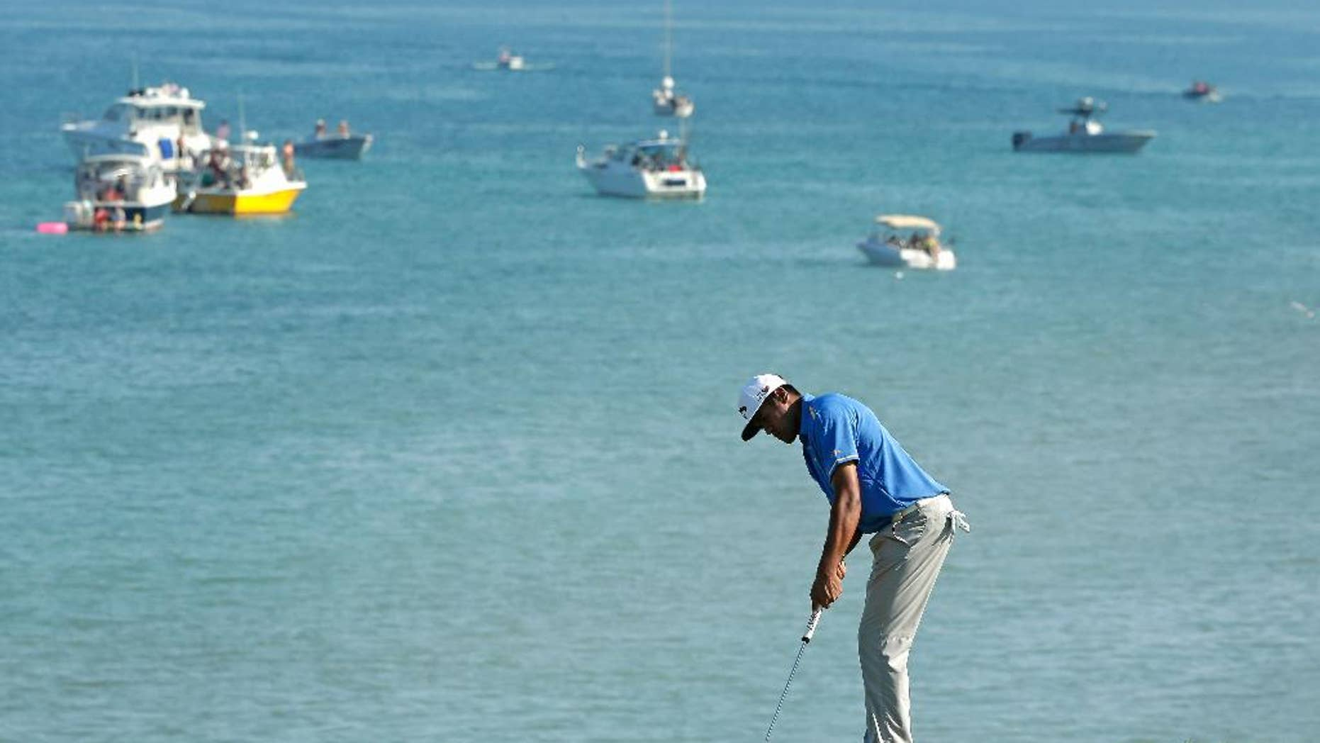 Tony Finau putts on the eighth hole during the third round of the PGA Championship golf tournament Saturday, Aug. 15, 2015, at Whistling Straits in Haven, Wis. (AP Photo/Chris Carlson)