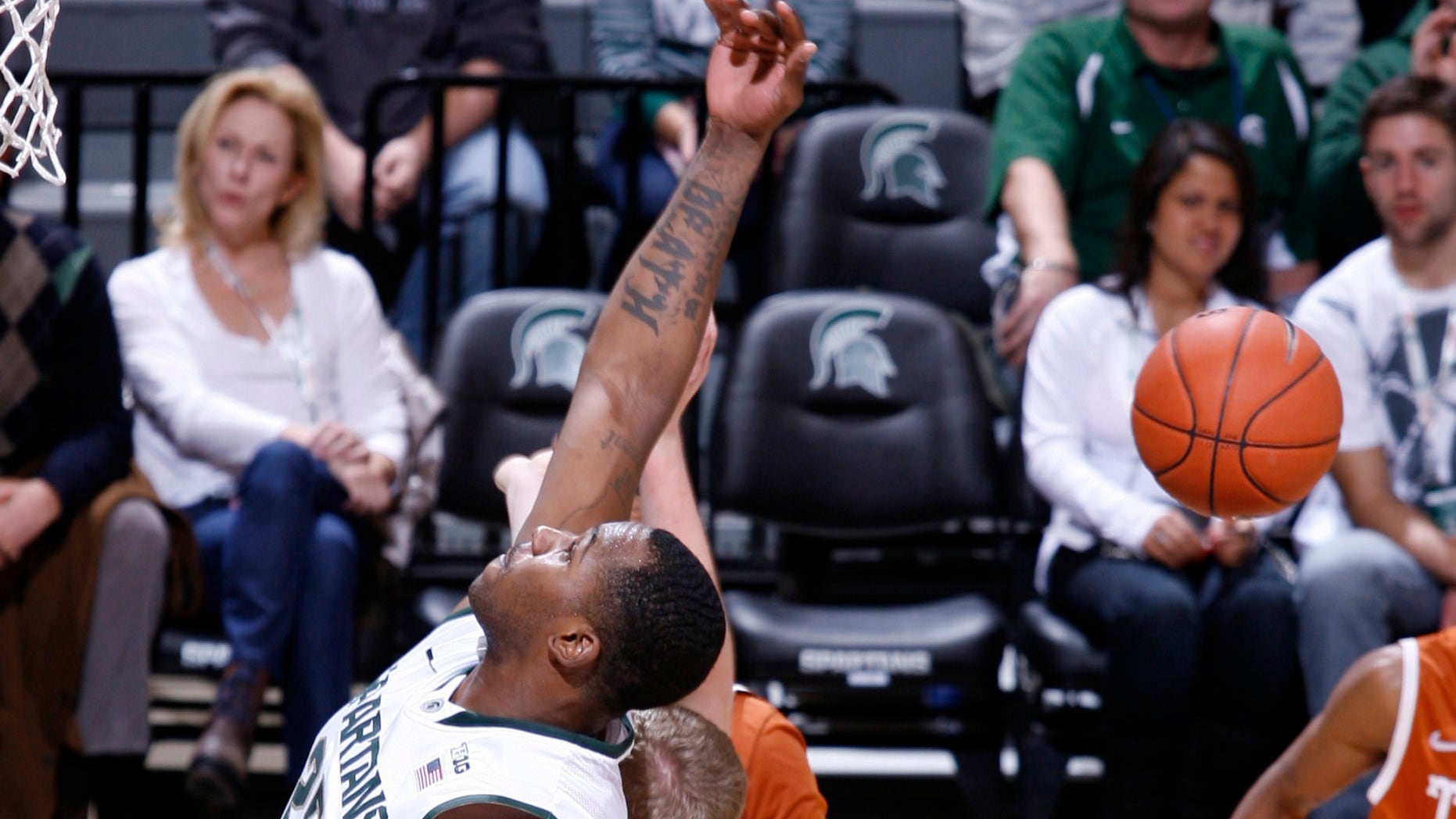 Michigan State's Derrick Nix, left, and Texas' Connor Lammert compete for a rebound during the first half of an NCAA college basketball game, Saturday, Dec. 22, 2012, in East Lansing, Mich. (AP Photo/Al Goldis)