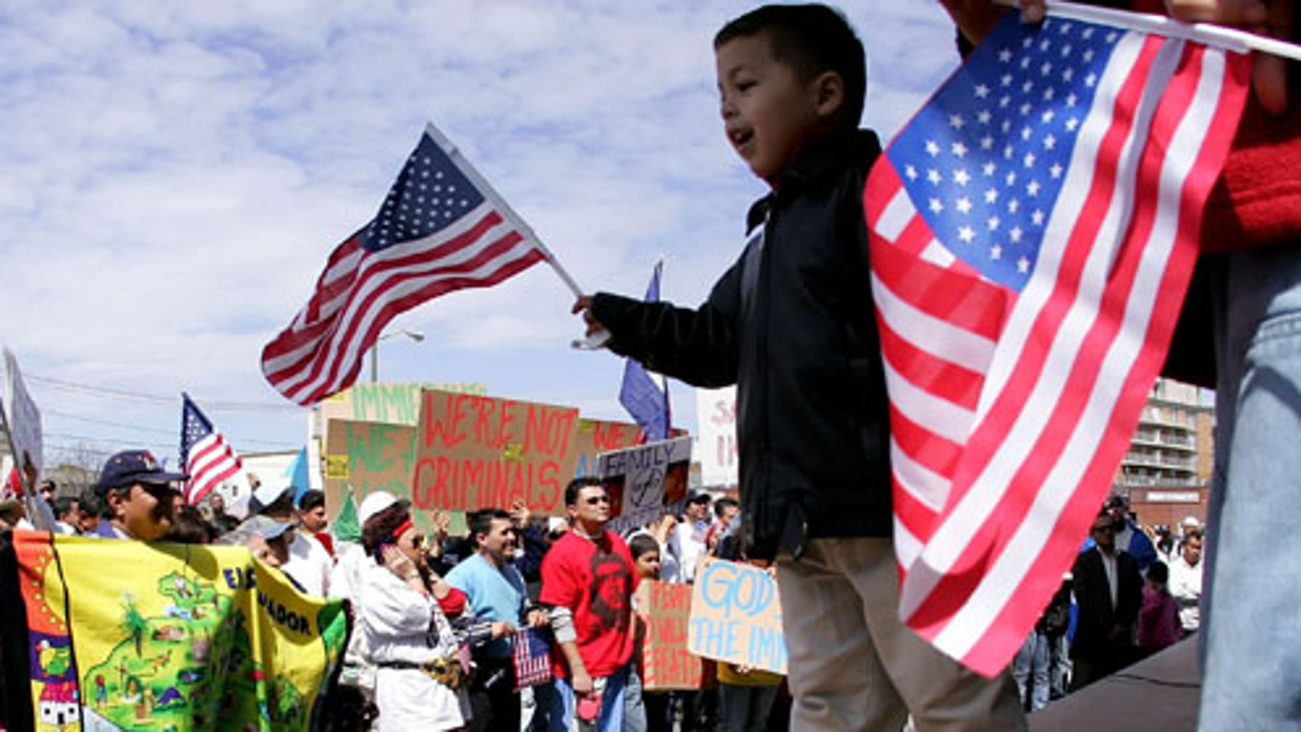 "HEMPSTEAD, NY - MAY 1:  Immigration demonstrators gathered for a rally at Hempstead Village Hall as part of the ""Day Without Immigrants"" national protest May 1, 2006 in Hempstead, New York.  On October 27, 2011, a report that immigrants, including Latinos, are thriving on Long Island. (Photo by John Dunn/Getty Images)"
