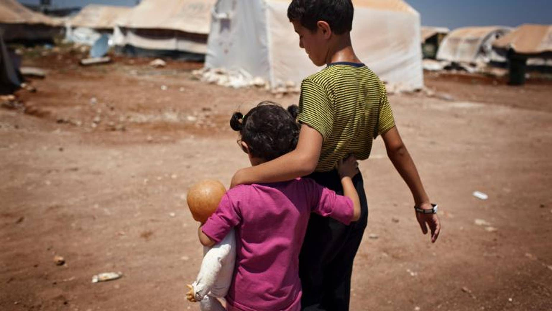 Syrian children walk in the Bab al-Salam refugee camp in Azaz on July 15, 2013