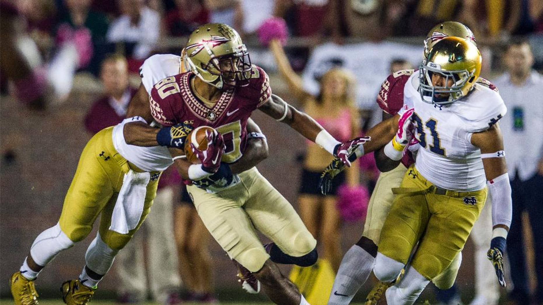 Florida State's Rashad Greene (80) returns a kickoff in the first half of an NCAA college football game against Notre Dame in Tallahassee, Fla., Saturday, Oct. 18, 2014. (AP Photo/Mark Wallheiser)