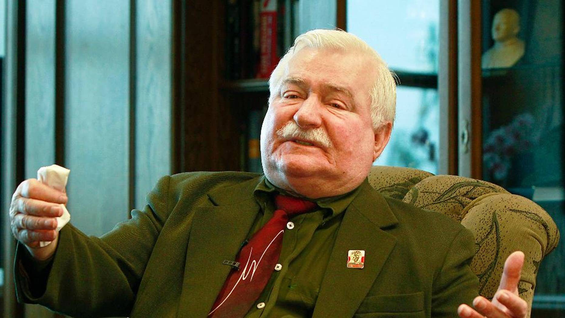 FILE- In this Wednesday, April 6, 2016 file photo, Poland's former president and legendary Solidarity freedom movement founder Lech Walesa gestures during an exclusive interview with The Associated Press at his office at the European Solidarity Center in Gdansk, Poland. The son of former Polish president Lech Walesa said Thursday, Oct. 13, 2016, that his father, a longtime adversary of Poland's current leadership, is being stripped of state protection when he travels abroad. (AP Photo/Czarek Sokolowski, File)