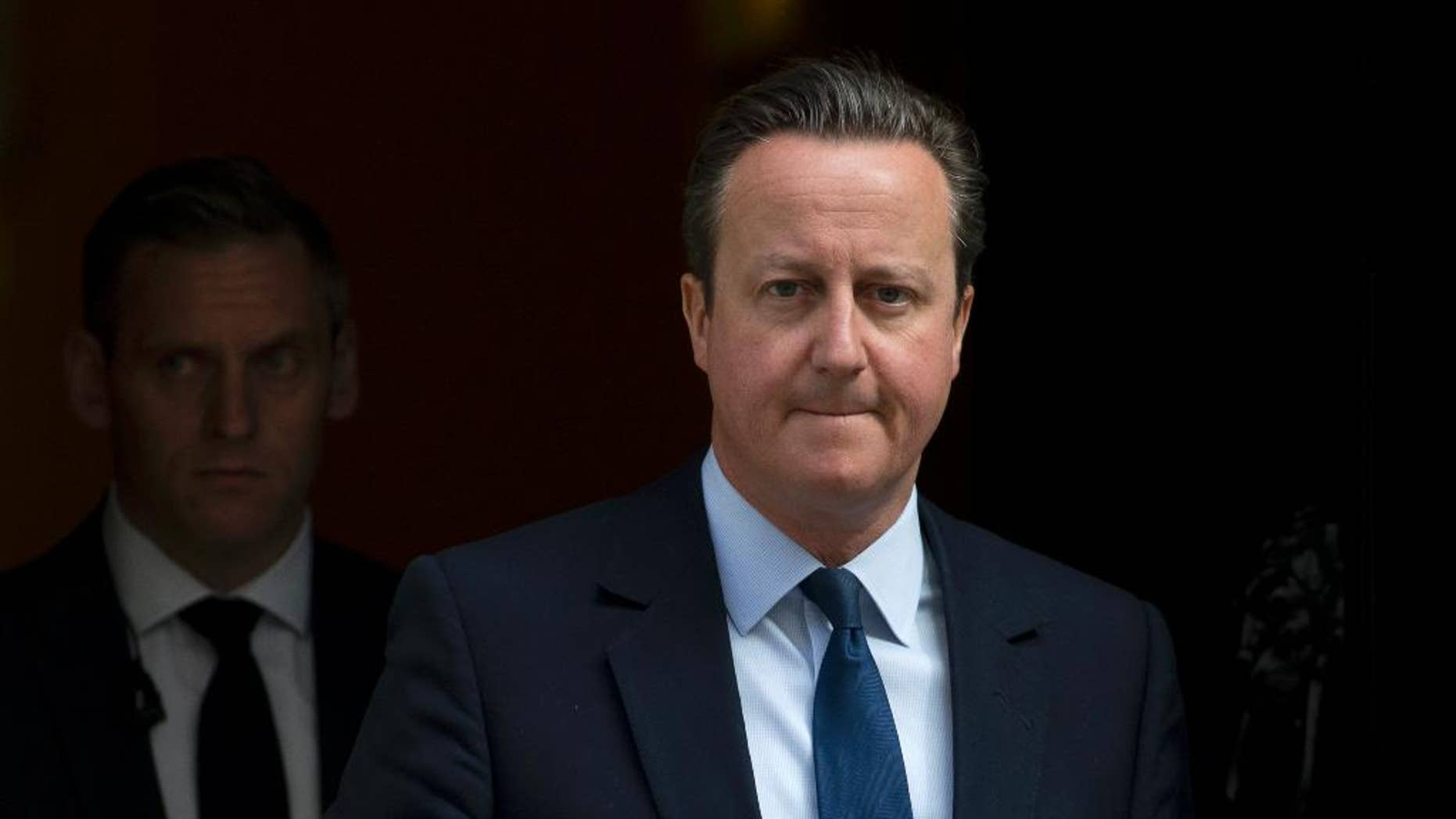 Britain's Prime Minister David Cameron leaves 10 Downing Street for the House of Commons to attend his weekly Prime Ministers Questions in London, Wednesday, April, 27, 2016. (AP Photo/Alastair Grant)