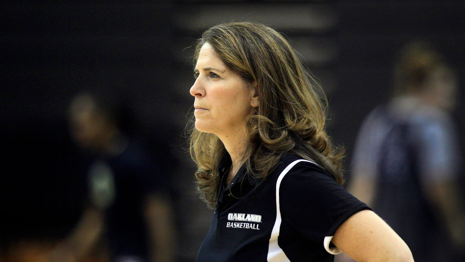 FILE - In this Oct. 16, 2012, file photo, Oakland University women's basketball coach Beckie Francis watches her team' practice in Rochester Hills, Mich. Oakland University says fired women's basketball coach  Francis physically and emotionally abused her players, was obsessed about their weight and pushed her Christian beliefs on them. The Detroit Free Press and The Oakland Press of Pontiac say the suburban Detroit-based public university made the statements in a brief responding to Francis's suit in Oakland County Circuit Court. (AP Photo/Carlos Osorio, File)
