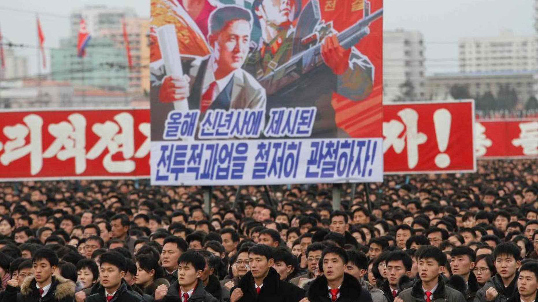 North Koreans gather during a mass rally to vow to carry through the tasks set forth by North Korean leader Kim Jong Un in his New Year's address, at Kim Il Sung Square in Pyongyang, North Korea Thursday, Jan. 5, 2017. (AP Photo/Jon Chol Jin)