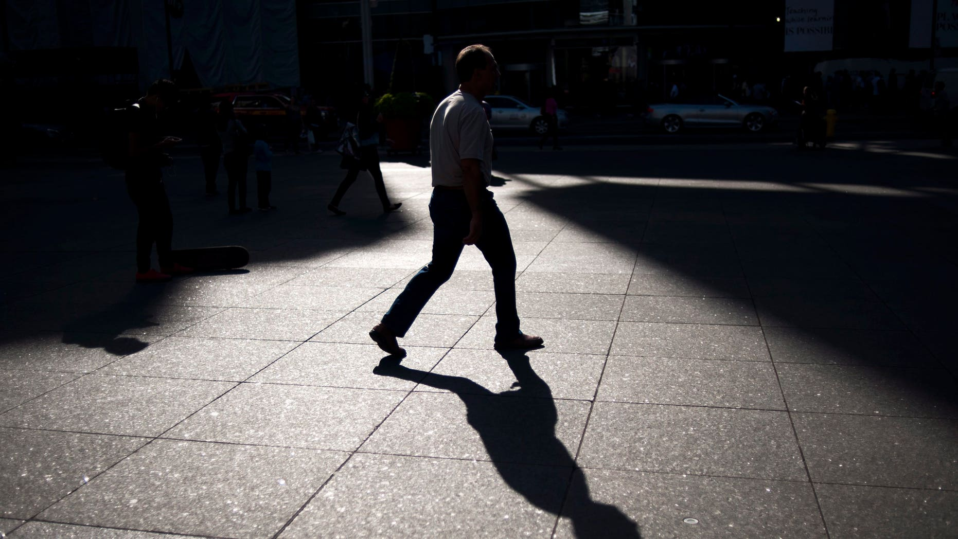 A person walks through Yonge and Dundas Square in Toronto, Friday, Sept, 25, 2015. (Marta Iwanek/The Canadian Press via AP) MANDATORY CREDIT