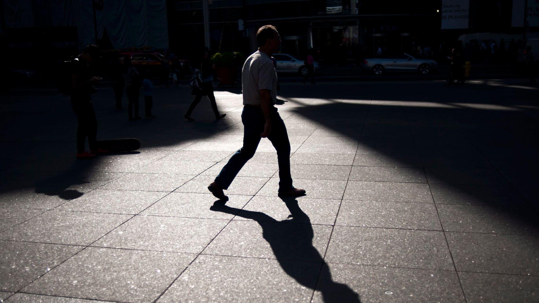 A person walks through Yonge and Dundas Square in Toronto, Friday, Sept, 25, 2015. (Marta Iwanek/The Canadian Press via AP) MANDATORY CREDIT
