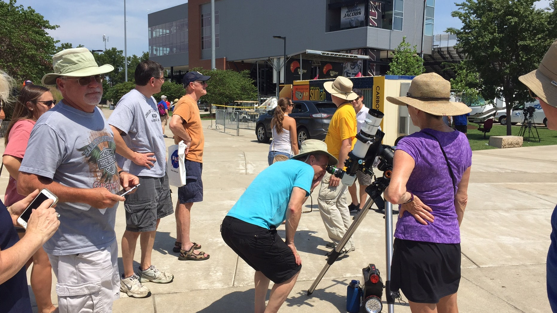 In Carbondale, Illinois, people look through a solar-viewing telescope in preparation for the total solar eclipse on Monday (Aug. 21).