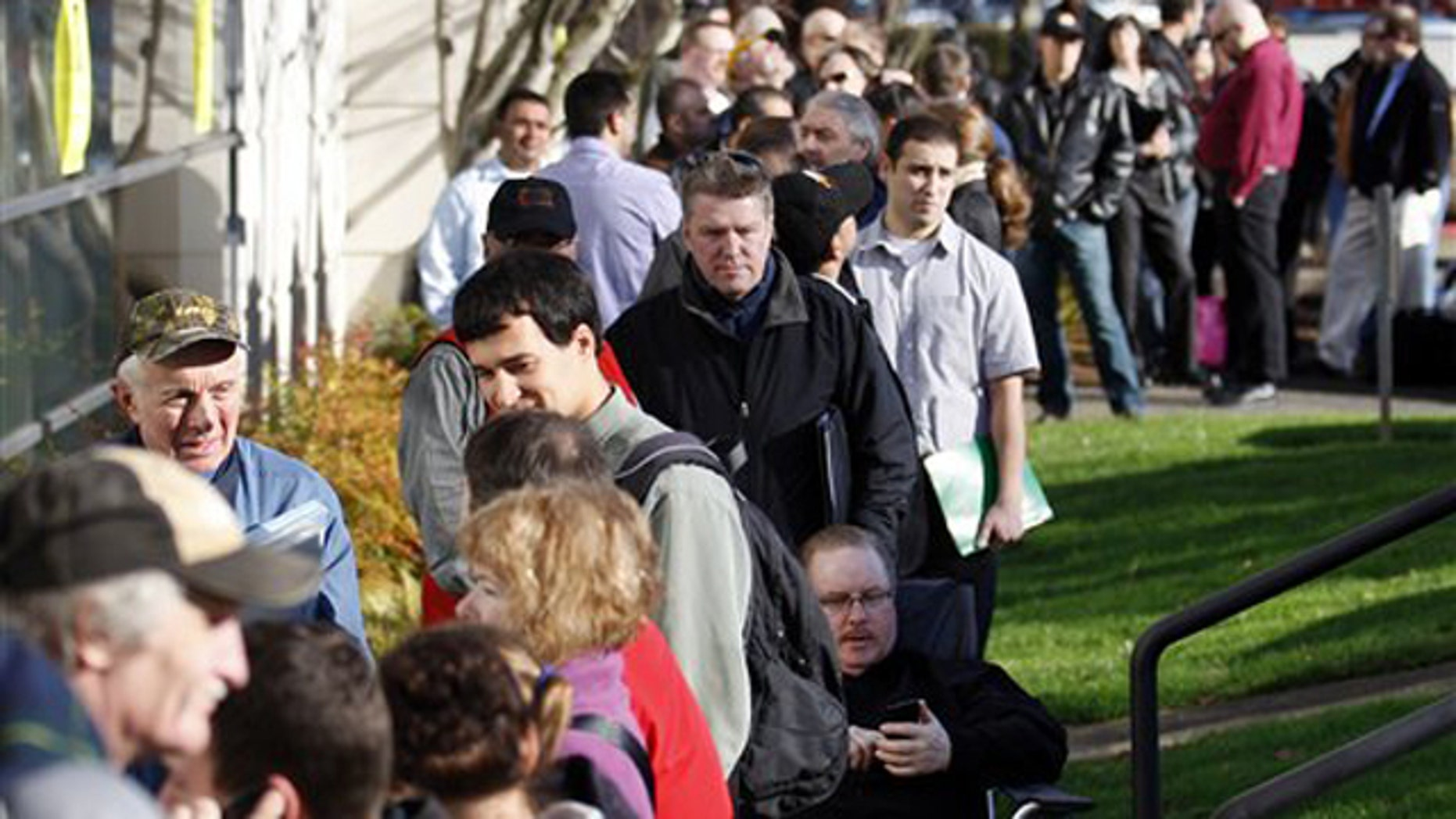 Feb. 2, 2012: People wait in line during a job fair for Home Depot at the WorkSource Oregon in Tigard, Ore.