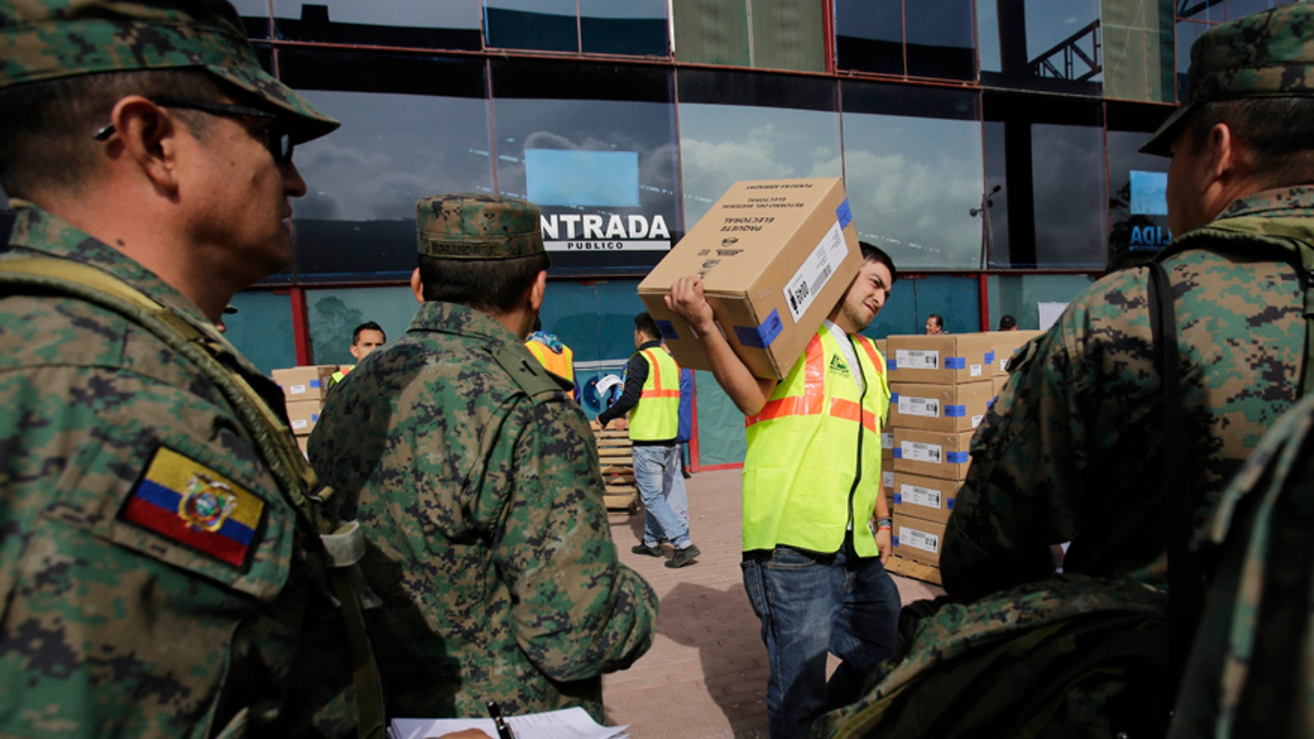 An Ecuador election official carries an electoral kit to be delivered to different polling places by the army, in Quito, Ecuador, Saturday, Feb. 18, 2017. Ecuadoreans will elect a new president, vice-president and National Assembly alongside a referendum on tax havens tomorrow. (AP Photo/Dolores Ochoa)