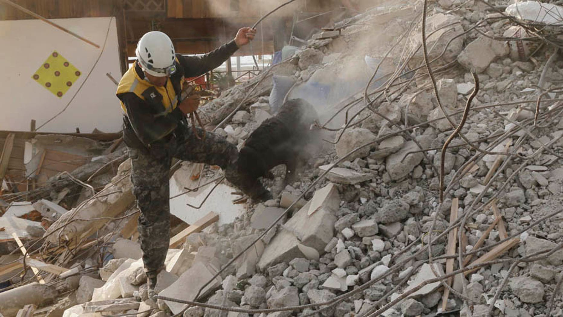 April 19, 2016: A dog rescue unit searches for survivors in the rubble of an earthquake collapsed building in Pedernales, Ecuador.