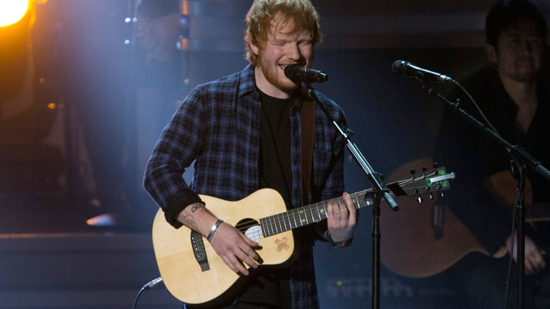 """British singer Ed Sheeran performs """"I Was Made To Love Her"""" during the taping of """"Stevie Wonder: Songs In The Key Of Life - An All-Star GRAMMY Salute"""" concert at the Nokia Theatre in Los Angeles, California February 10, 2015."""