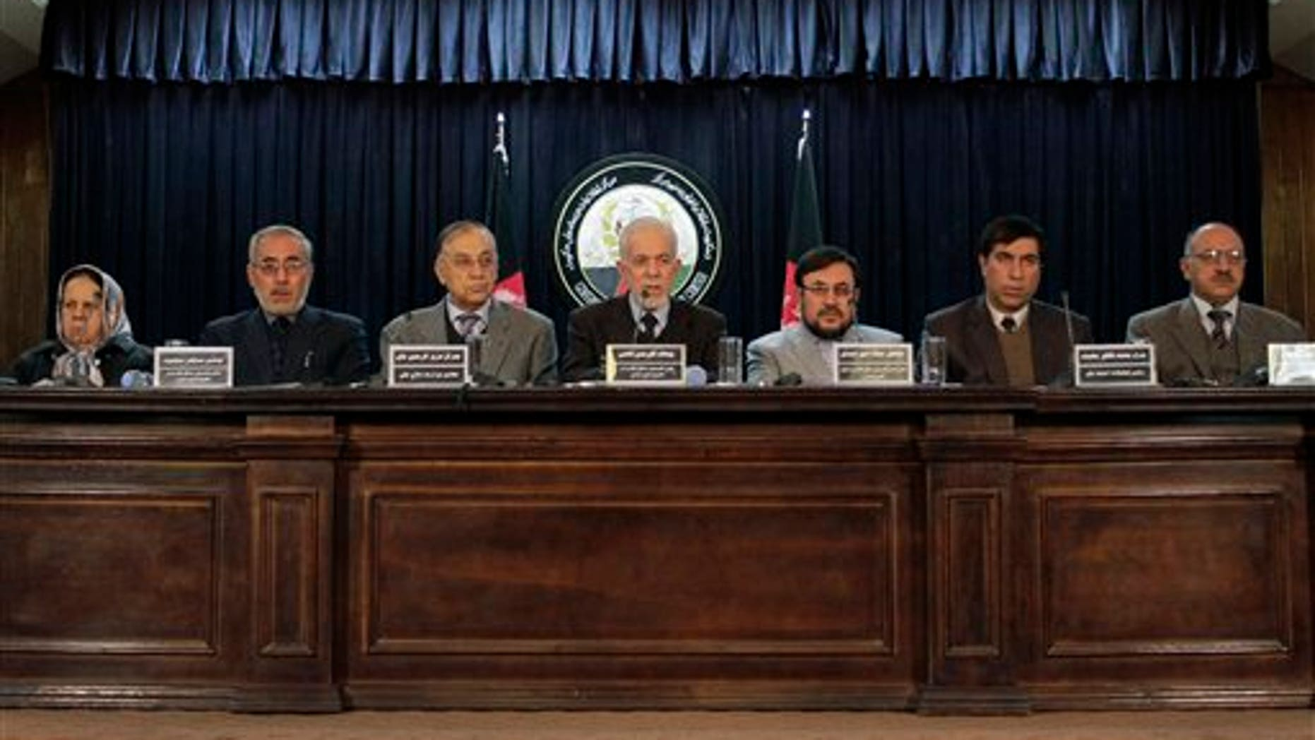 Jan. 7: Gul Rahman Qazi, center, head of an Afghan investigative commission, speaks during a news conference in Kabul, Afghanistan.