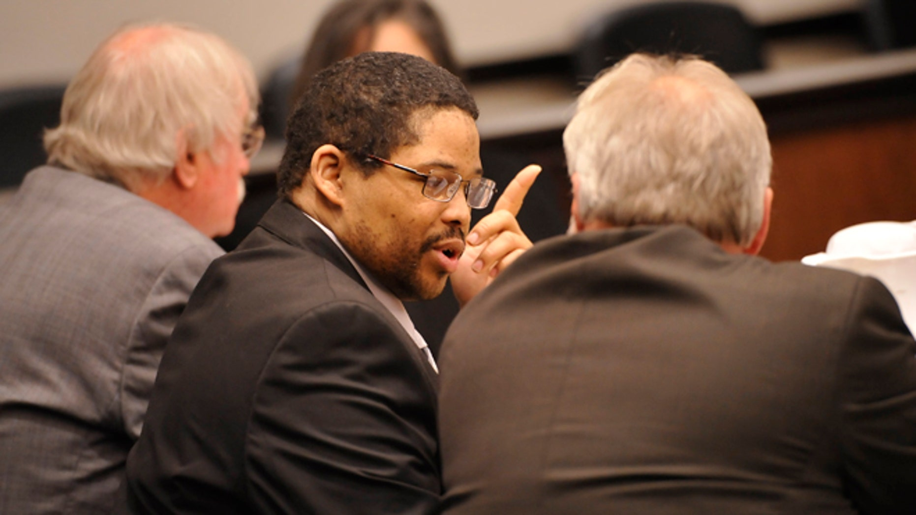 April 22, 2013: In this file photo, Bartholomew Granger, center, is flanked by attorneys James Makin, right, and Sonny Cribbs before the start of his trial in Galveston, Texas.
