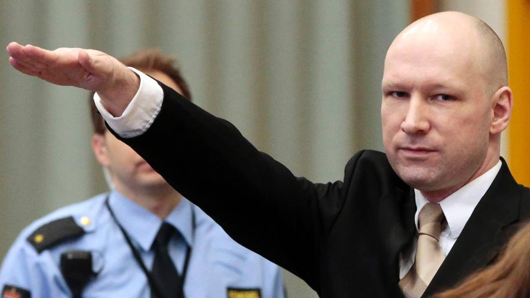 FILE - In this Tuesday, March 15, 2015 file photo, Anders Behring Breivik gestures as he enters a courtroom in Skien, Norway. Breivik, who killed 77 people in a bombing and shooting rampage in 2011, is returning to court this week as the government appeals a ruling that his isolation in prison breaches the European Convention on Human Rights. (Lise Aserud, NTB Scanpix via AP, File)