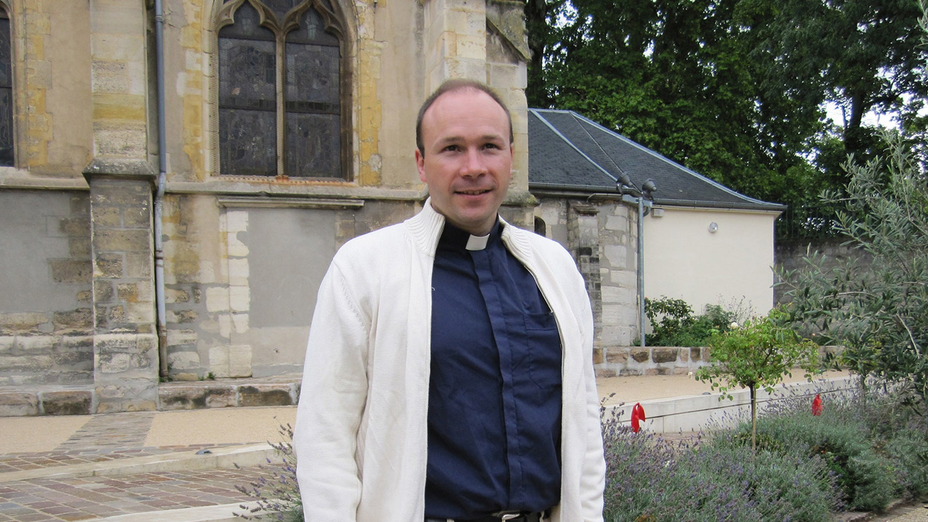 FILE - This July 2011 handout photo provided by the Sceaux City Hall, north of Paris, shows French priest Georges Vandenbeusch.  Vandenbeusch was kidnapped in Cameroon in mid-November has been set free, President Francois Hollande's office said Tuesday Dec. 31, 2013. Vandenbeusch was kidnapped by heavily armed men on Nov. 13 in the far north of Cameroon, about 18 miles (30 kilometers) from the border with Nigeria (AP Photo/Sceaux City Hall, File)