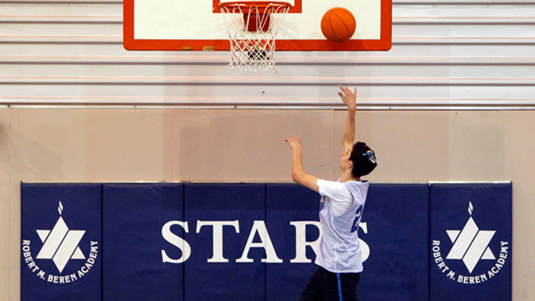 Feb. 28, 2012: Roni Buchine, 14, practices with the Beren Academy boys' basketball team in Houston.