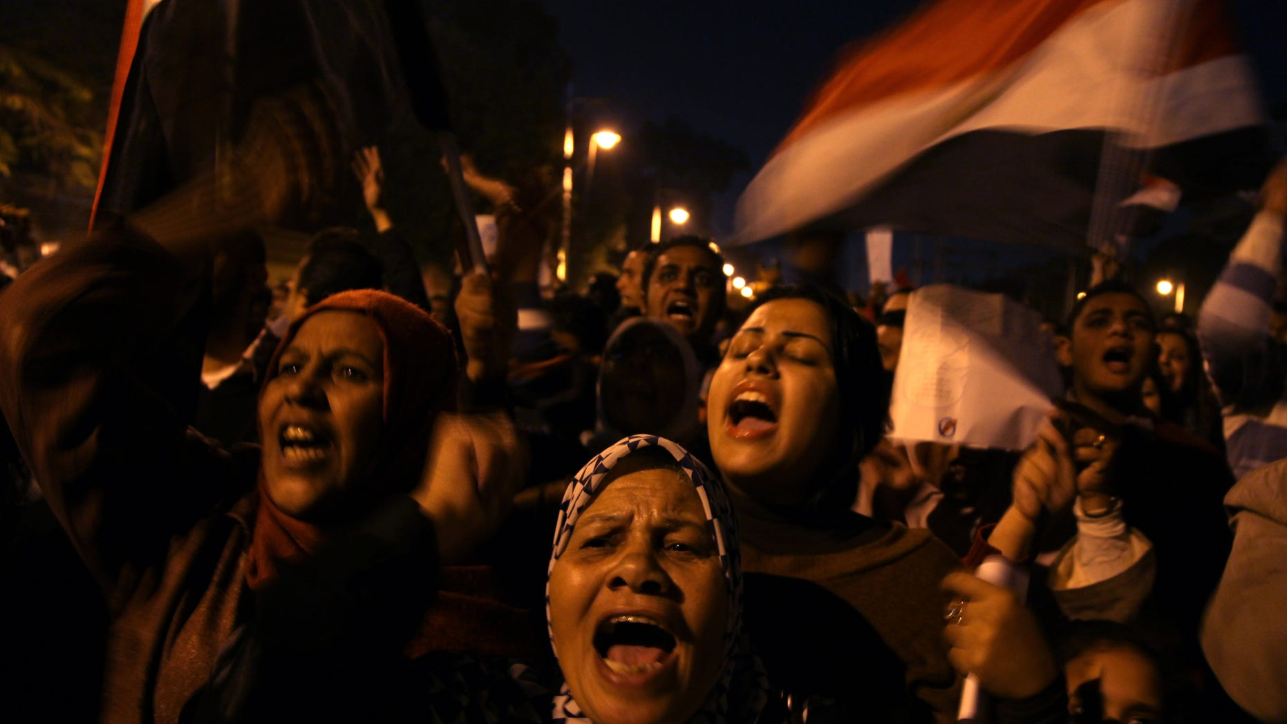 Dec, 18, 2012: Egyptian protesters opposing president Mohammed Morsi chant slogans during a protest against President Mohammed Morsi, in front of the presidential palace  in Cairo, Egypt.