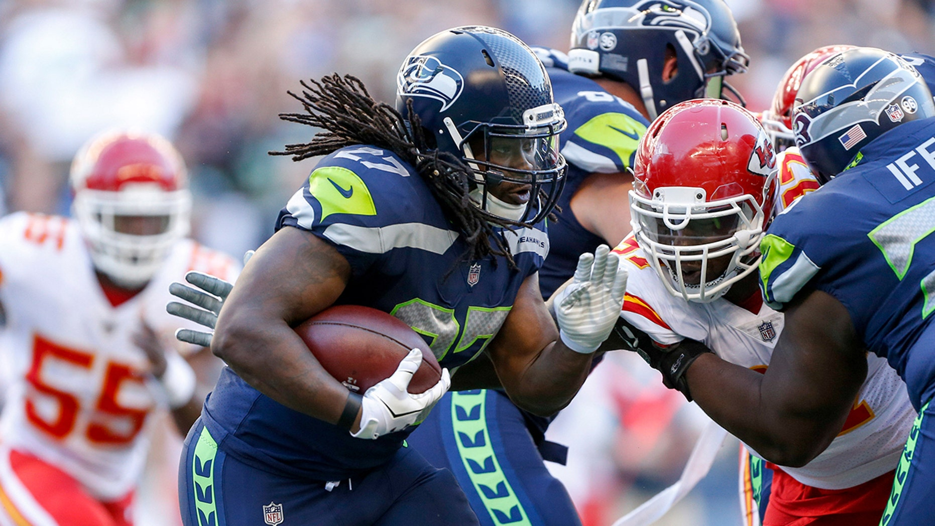 Seattle Seahawks running back Eddie Lacy (27) rushes against the Kansas City Chiefs the first quarter at CenturyLink Field on August 25, 2017.