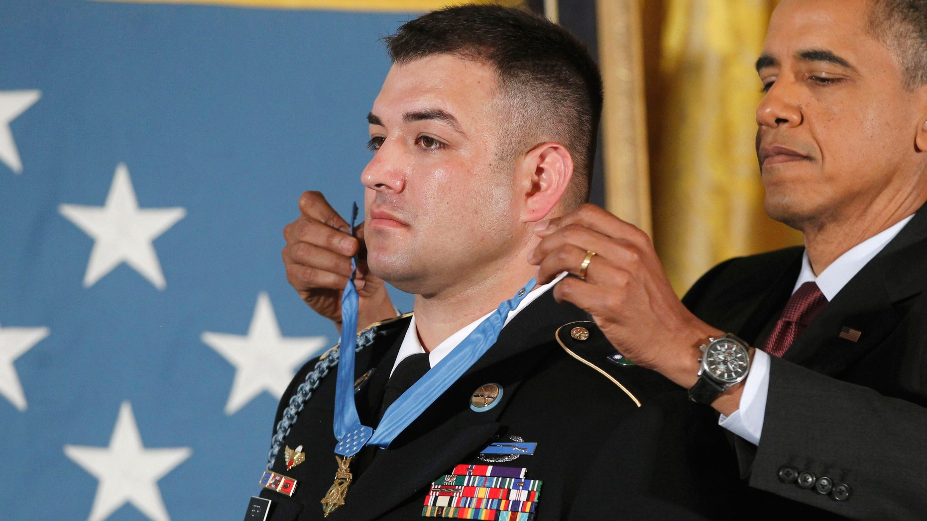 President Barack Obama awards US Army Sgt. First Class Leroy Arthur Petry, from Santa Fe, N.M., the Medal of Honor during a ceremony in the East Room of the White House in Washington.