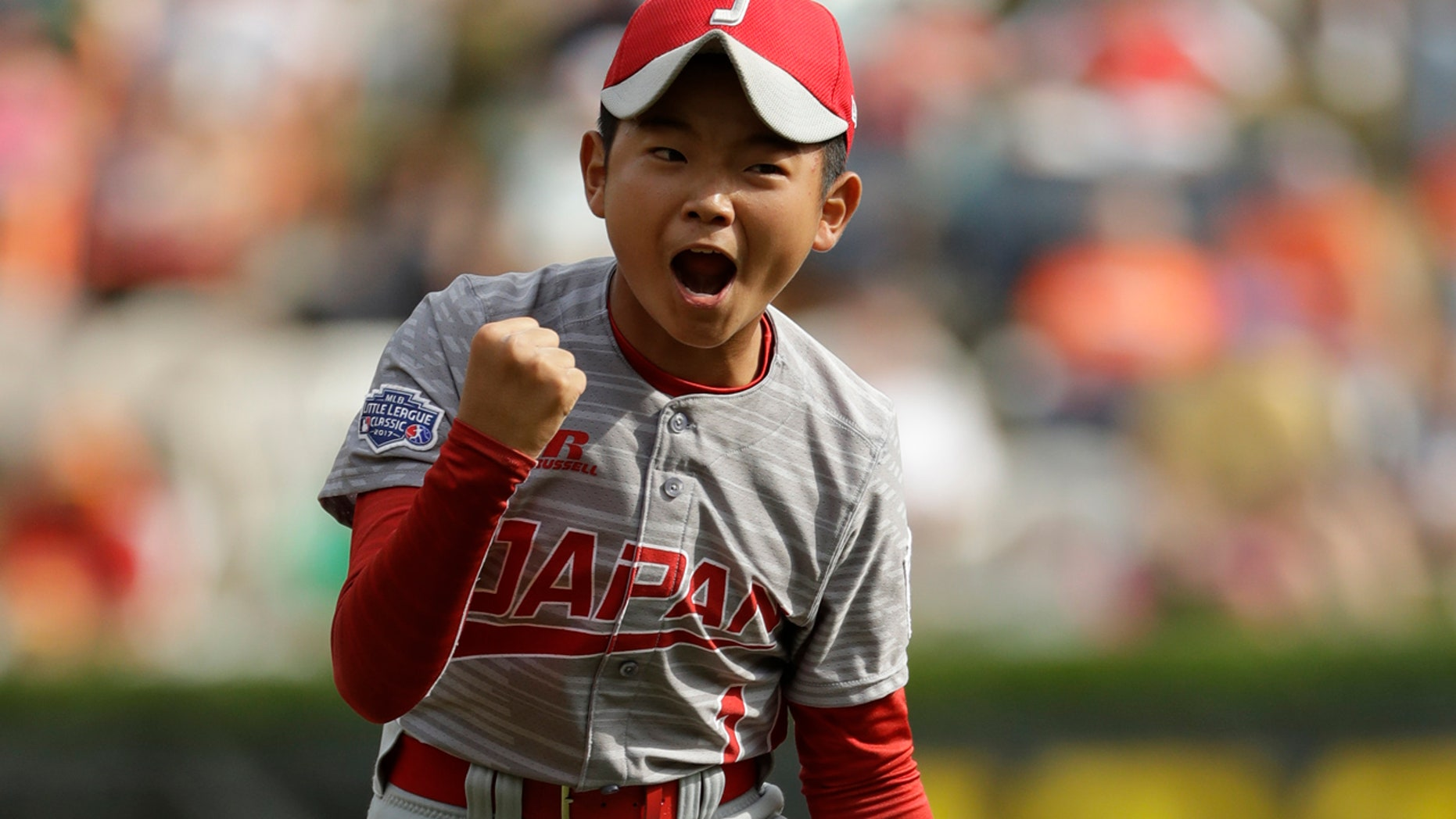 Aug. 27: Japan's Tsubasa Tomii celebrates an out during the Little League World Series Championship baseball game against Lufkin, Texas, in Pa.