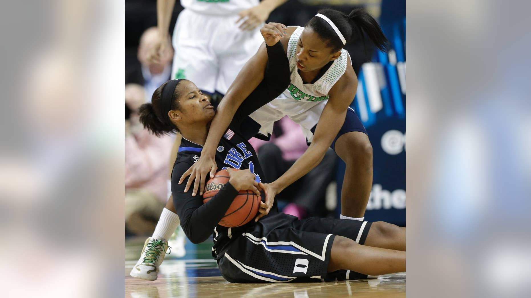 Notre Dame's Lindsay Allen, right, reaches in on Duke's Ka'lia Johnson, left, during the second half of the NCAA college basketball championship game in the Atlantic Coast Conference tournament in Greensboro, N.C., Sunday, March 9, 2014. (AP Photo/Chuck Burton)