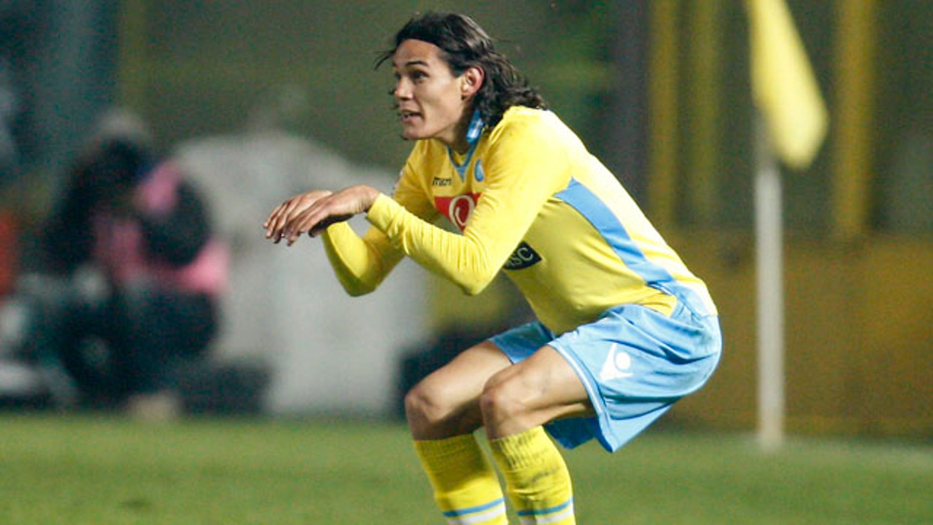 Napoli forward Edinson Cavani, of Uruguay, celebrates after scoring a last minute equalizer during the Serie A soccer match between Atalanta and Napoli in Bergamo, Italy, Saturday, Nov. 26, 2011. The match ended in a 1 - 1 tie. (AP Photo/Antonio Calanni)